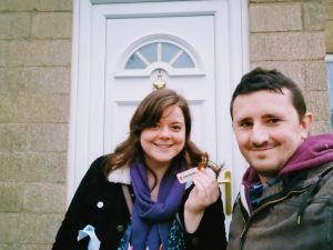 Justine and Scott outside their new home