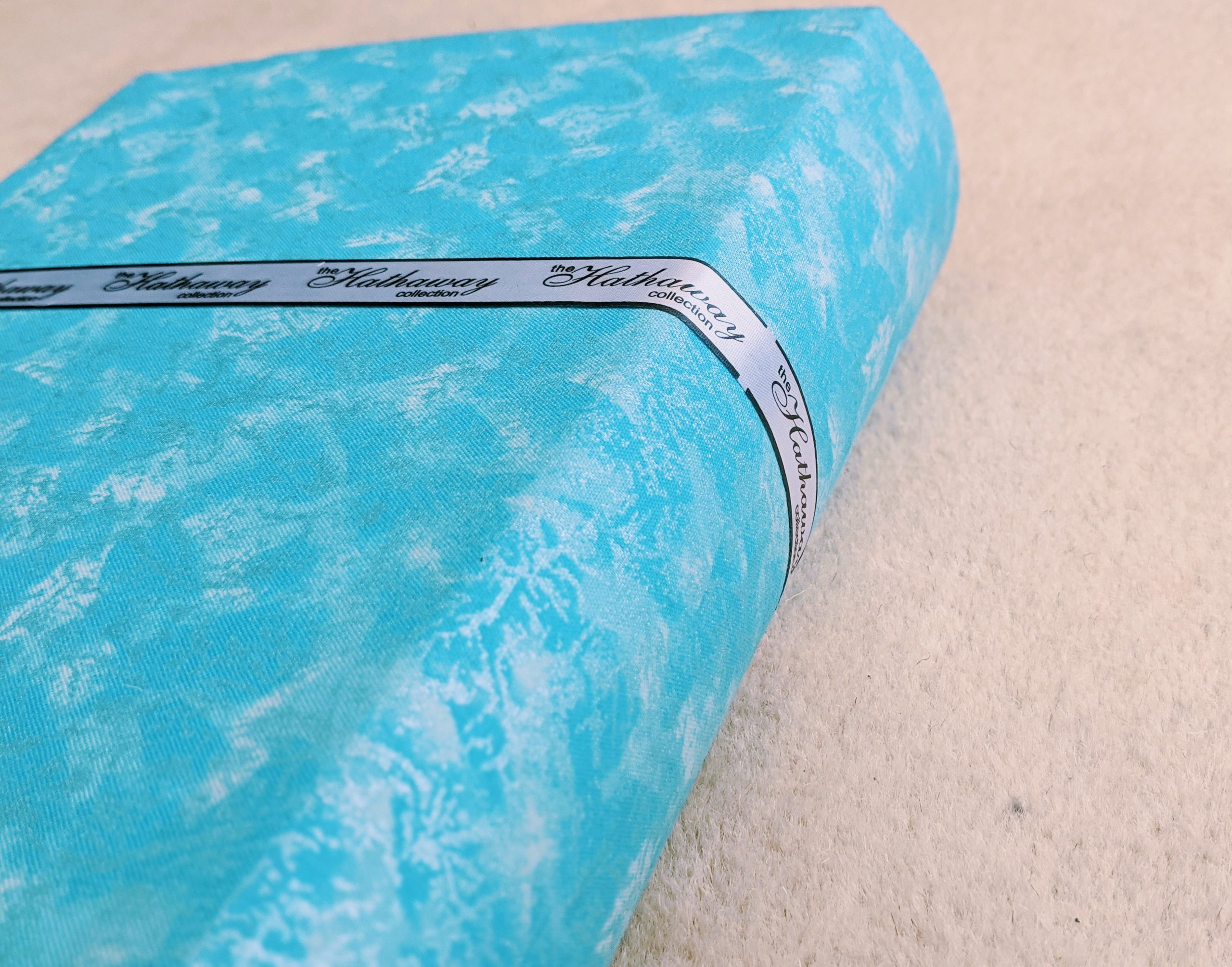 A close up of the ribbon around the back and spine of our keepsake book