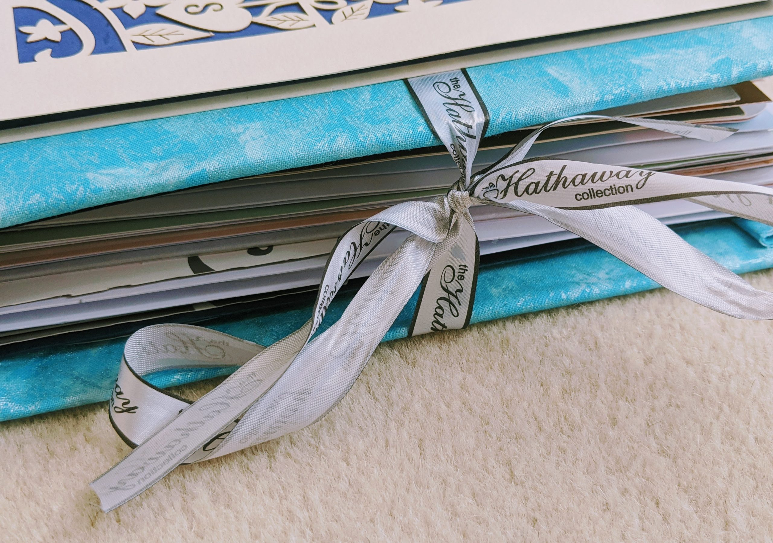 Close up of the ribbon holding our wedding card keepsake book together