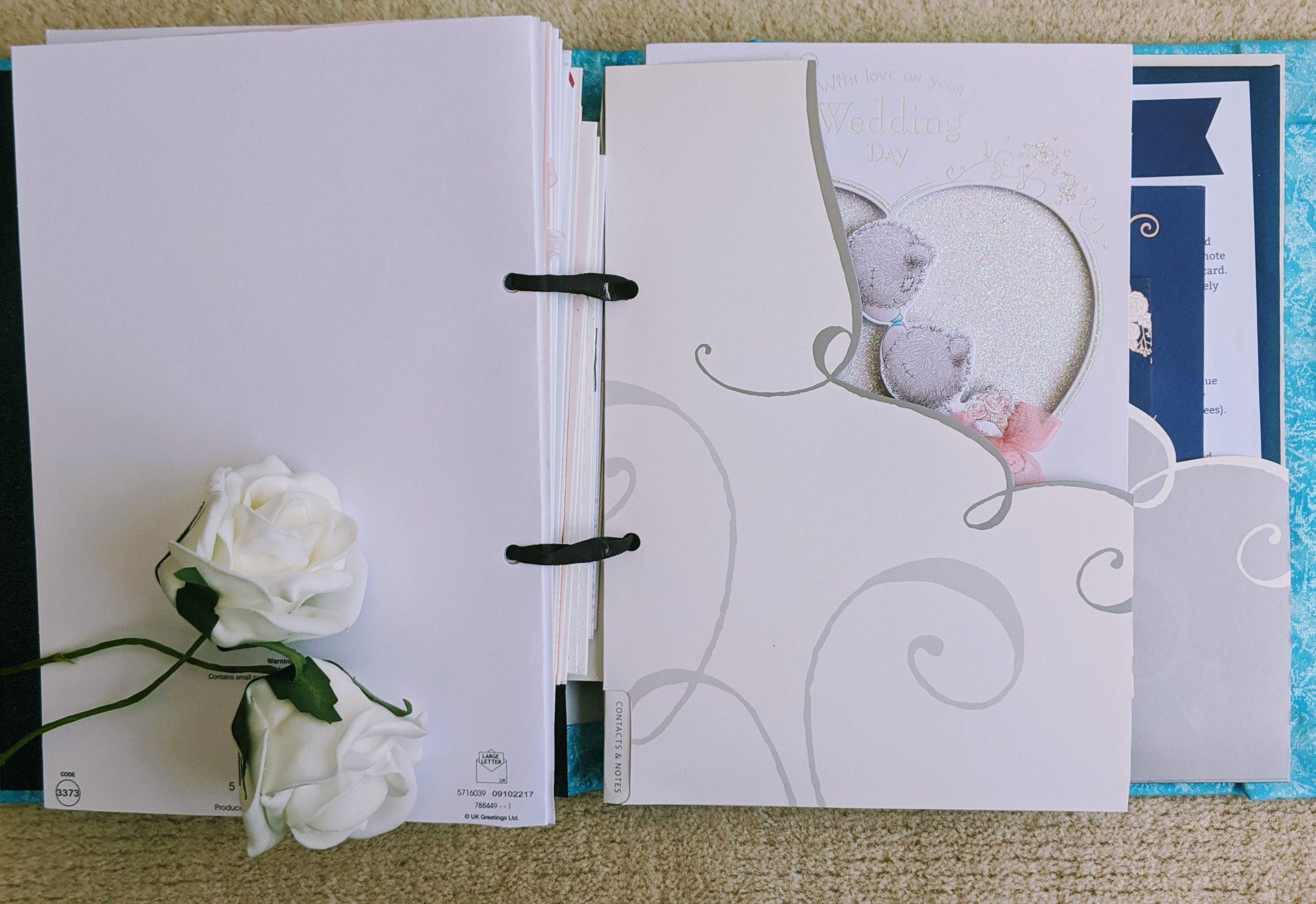 Repurposed folder pockets in our greeting card keepsake book