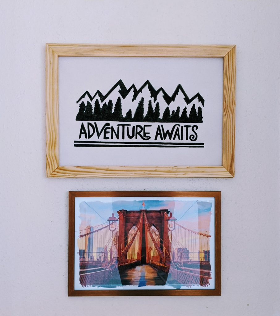Finished DIY canvas art - Adventure Awaits picture hanging up