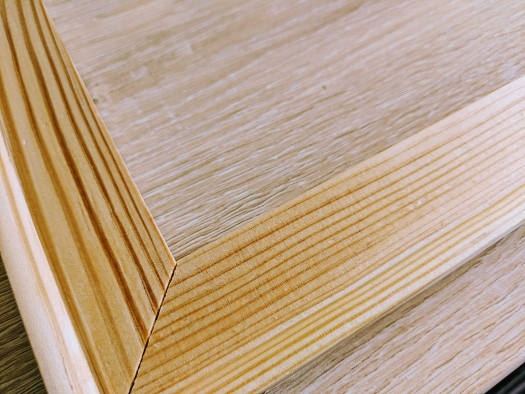 Oiling and sanding the wooden canvas frame