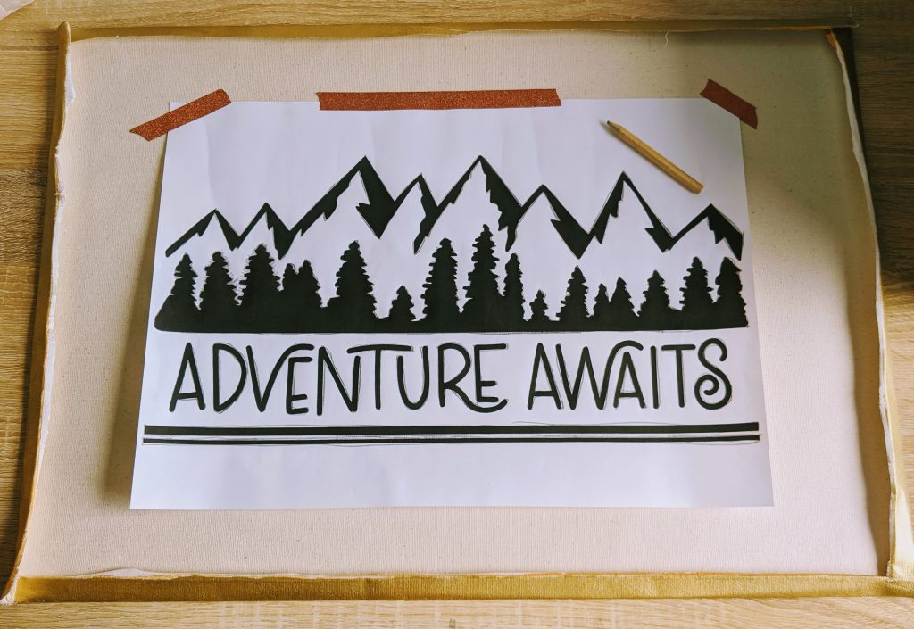Tracing the Adventure Awaits image onto the canvas
