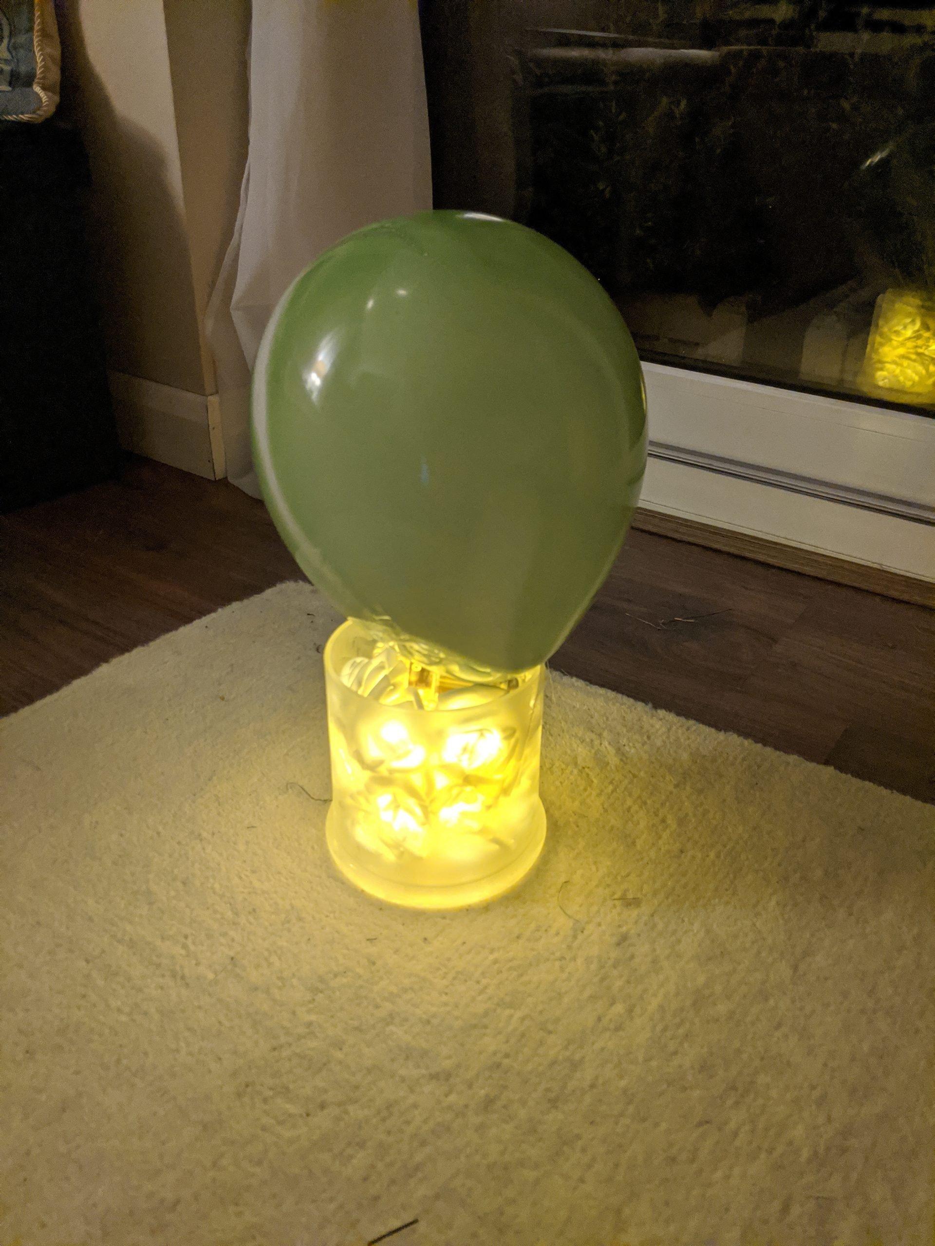 Taping balloon on mason jar