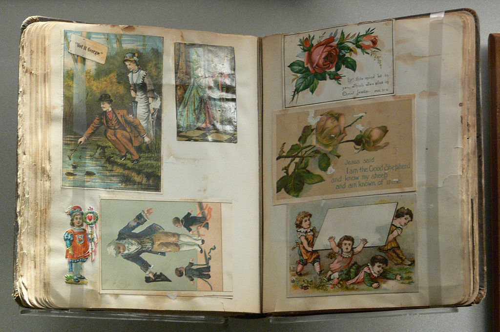 Antique scrapbook containing printed cards