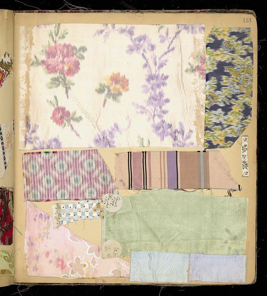 Vintage scrapbook full of fabric scraps